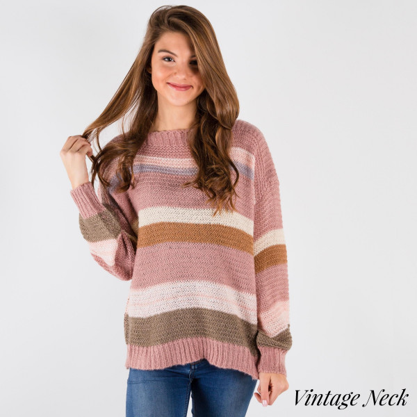 Soft waist length sweater with loose fit. 55% Acrylic 45% Cotton