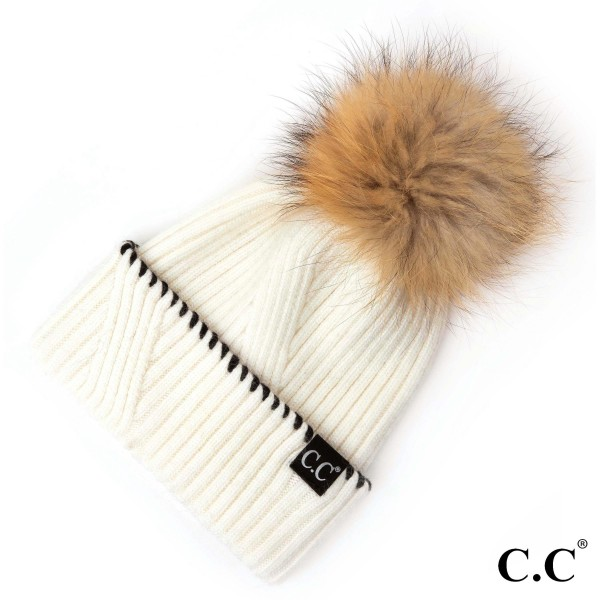 ST-71 C.C- Black whipstitched cuff ribbed hat with real fur pom. 20% Angora-80% Acrylic- One size.
