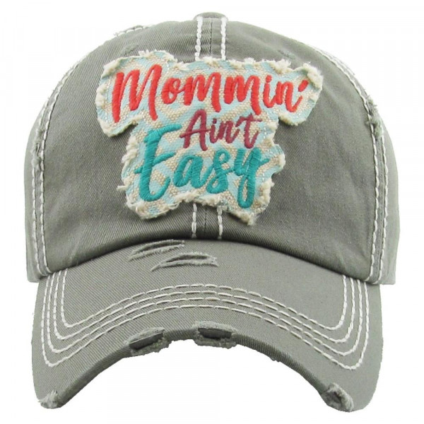 """Vintage, distressed baseball cap featuring """"Mommin' Ain't Easy"""" embroidered detail.  - 100% Cotton - Adjustable velcro closure - One size fits most"""