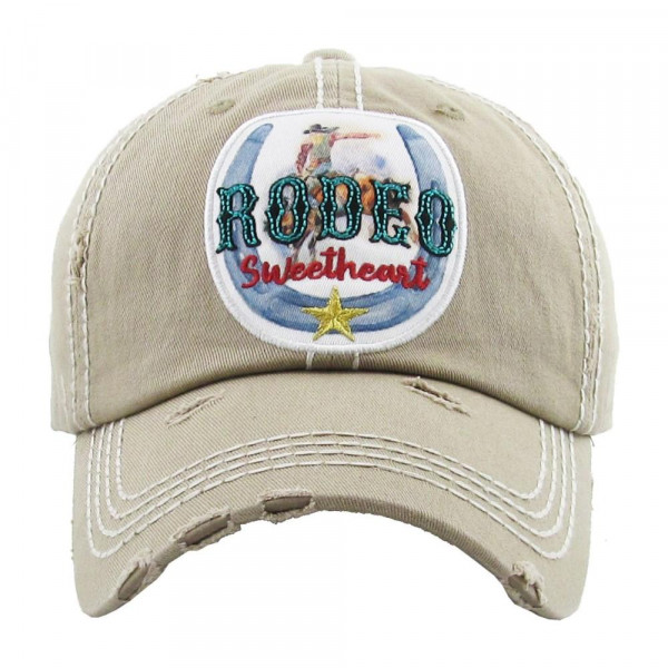 """Vintage, distressed baseball cap featuring """"Rodeo Sweetheart"""" embroidered details.  - 100% Cotton - Adjustable velcro closure - One size fits most"""