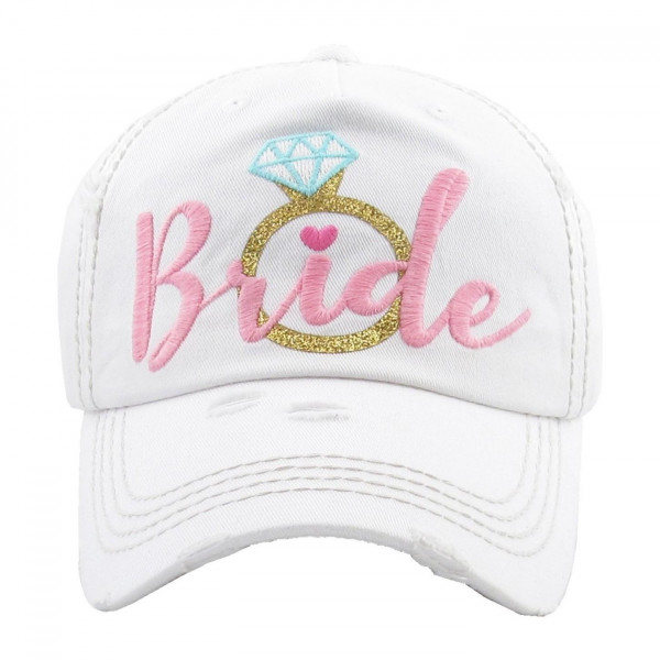 """Distressed vintage style """"Bride"""" baseball cap featuring a embroidered ring detail and adjustable velcro closure.   One size fits most.  Composition: 100% Cotton."""