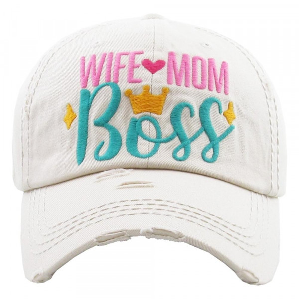 "Vintage, distressed baseball cap featuring ""Wife Mom Boss"" embroidered details.  - 100% Cotton - Adjustable velcro closure - One size fits most"