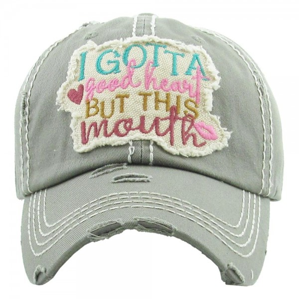 "Vintage, distressed baseball cap featuring ""I gotta good heart but this mouth"" embroidered detail.  - One size fits most  - Adjustable velcro closure - 100% Cotton"