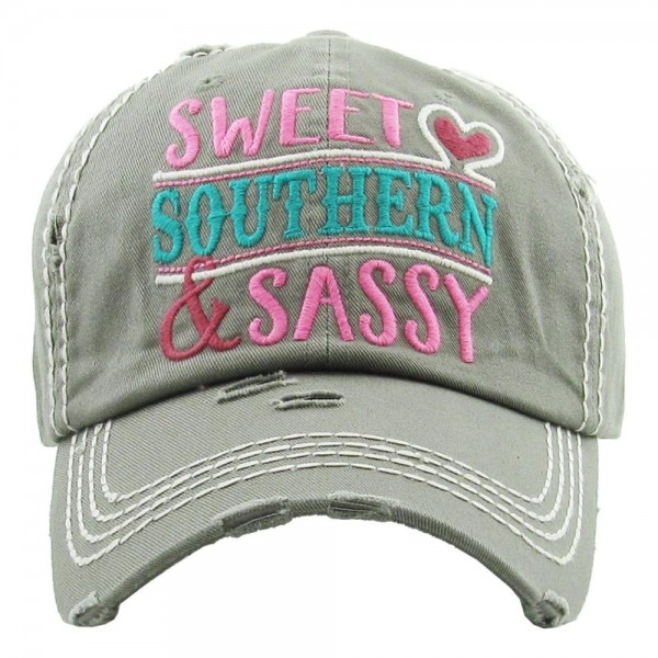 "Vintage, distressed baseball cap featuring ""Sweet Southern & Sassy"" embroidered detail.  - One size fits most  - Adjustable velcro closure - 100% Cotton"