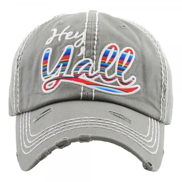 "Vintage, distressed baseball cap featuring ""Hey Y'all"" serape embroidered detail.  - One size fits most  - Adjustable velcro closure - 100% Cotton"