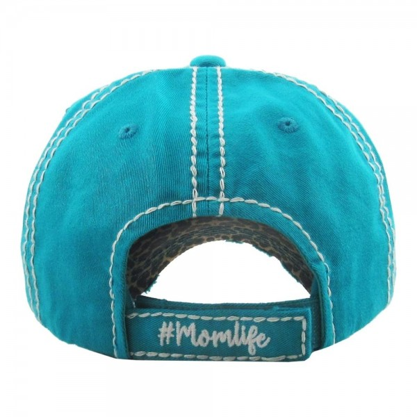"Vintage, distressed baseball cap featuring ""#Momlife"" leopard print embroidered detail.  - One size fits most  - Adjustable velcro closure - 100% Cotton"