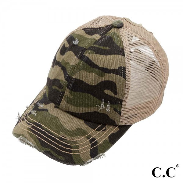 C.C Pony Cap BT-783 Distressed camo pony cap with mesh back  - Adjustable velcro closure  - Elastic criss cross pony tail opening  - One size fits most - 60% Cotton, 40% Polyester