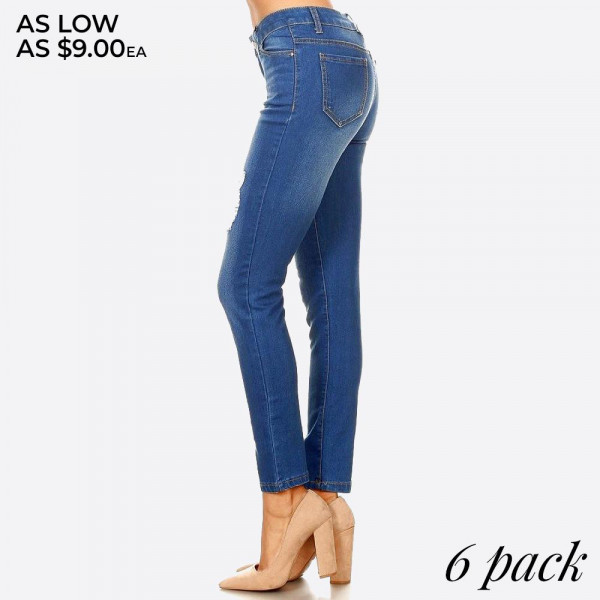 Distressed medium wash skinny jean jeggings with button and zipper.  - Body shaping silhouette - Classic jean closure style  Comes in a 6 pack: 1S,2M,2L,1XL