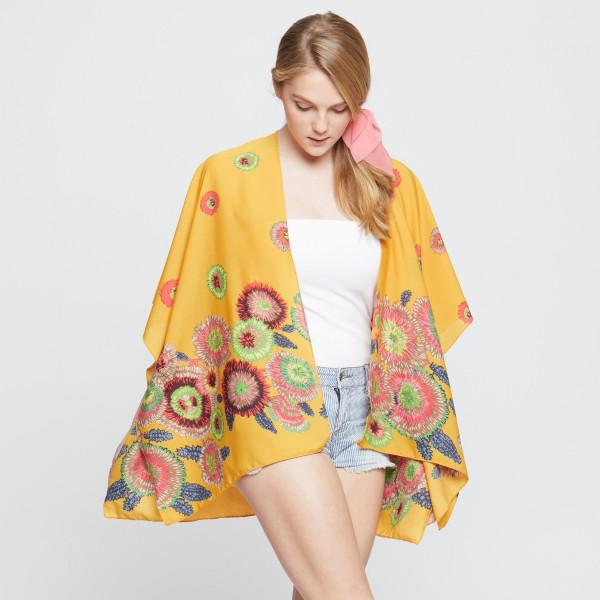 Floral printed kimono. 100% polyester.