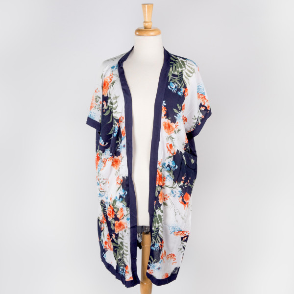 "Lightweight navy blue kimono featuring a floral print. Approximately 38"" in length."