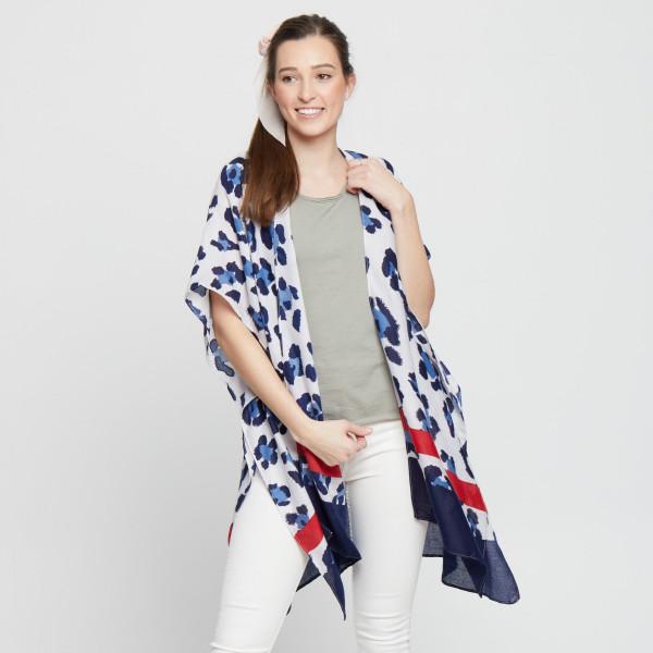 Leopard print kimono. 100% polyester.