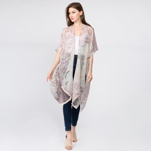 Paisley lurex print kimono. 100% polyester. One size 0-14.