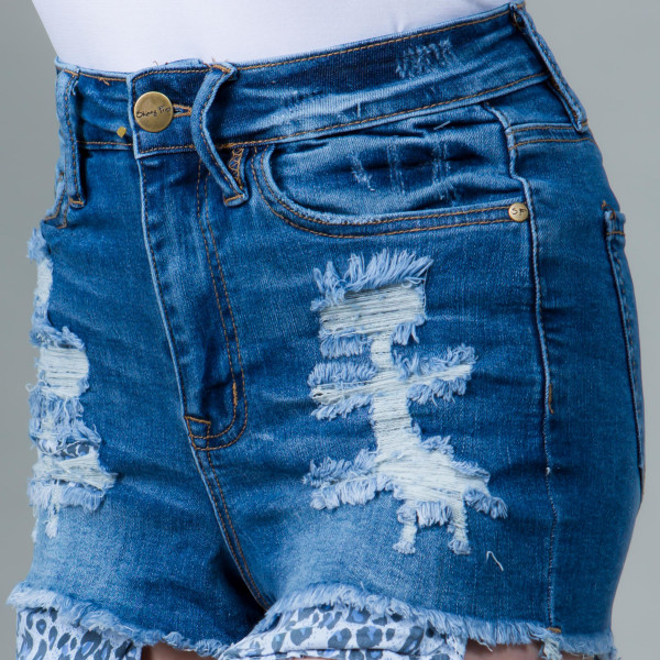 A pair of distressed denim shorts with great stretch featuring a low rise, five-pocket construction, a zip fly, and frayed hem. Leopard print detail.   97% cotton, 3% spandex   Size:1/3/5/7/9/11/13/Total Pack:1/2/2/2/2/2/1/12