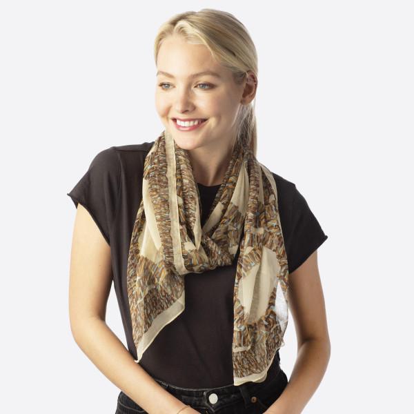 Lightweight silky oblong scarf. 100% polyester.