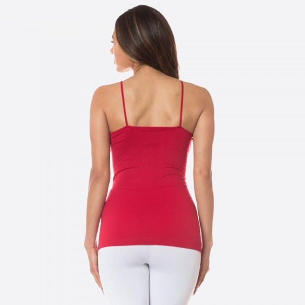 The summer must have is here! This sexy cami top features spaghetti straps, solid color, sleeveless and crisscross design. Wear this top with distressed shorts and take on summer in style! 