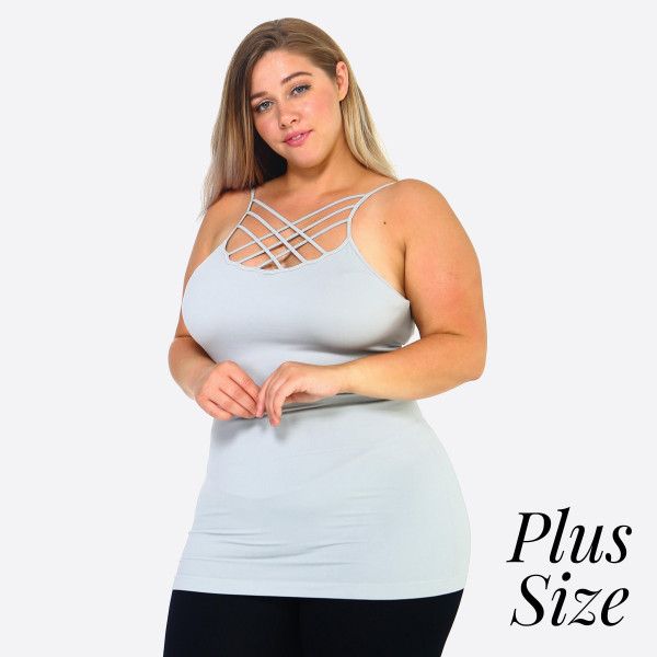 The summer must-have is here! This sexy cami top features spaghetti straps, sleeveless design, and a crisscross front. Wear this top with distressed shorts and take on summer in style!  One size fits most plus 16-22. See size chart.   - Scoop-neck  - Solid Color - Unique Crisscross Front  - Spaghetti Straps  - Ultra Soft  - Stretchy Knit  - Machine Wash  - Imported   Content: 92% Nylon, 8% Spandex