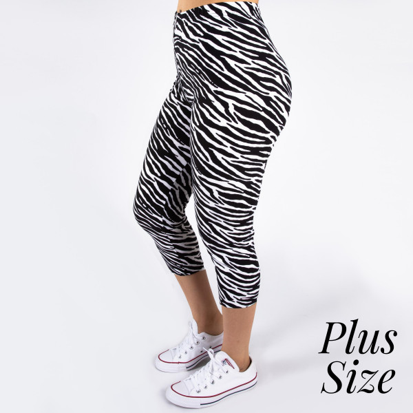 """PLUS SIZE peach skin zebra print capri style leggings. Inseam approximately 19"""".  - One size fits most 16-20  - Composition: 92% Polyester, 8% Spandex/Elasthanne"""