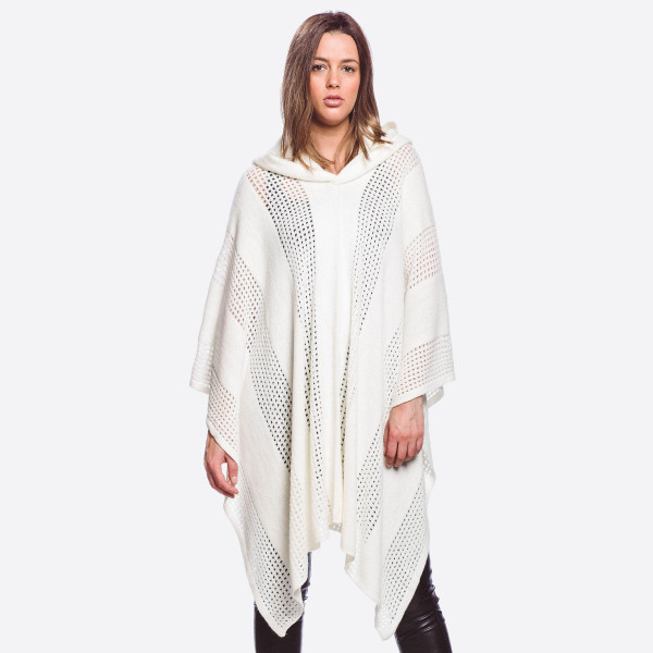 """Knit poncho featuring a hood with shark bite hem details.  - One size fits most 0-14 - Approximately 27"""" in length - 100% Acrylic"""