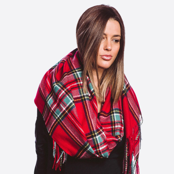 "Plaid check oblong scarf with fringes.  - One size fits most  - Approximately 70"" L x 27"" W  - Composition: 100% Polyester"