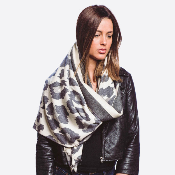 "Leopard print oblong scarf.  - Approximately 70""L x 29""W  - 20% Cashmere, 80% Cotton"