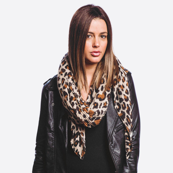 """Lightweight leopard print scarf.  - Approximately 34"""" W x 70"""" L - 100% Polyester"""
