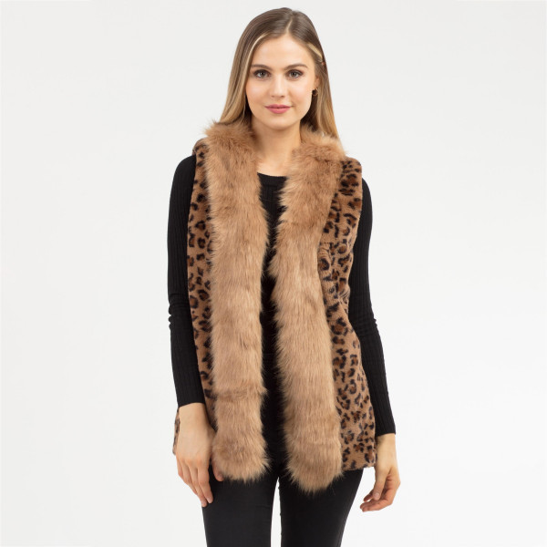 """Faux fur leopard print vest with fur trim and side pocket details.  - One size fits most 0-14 - Approximately 25"""" in length - 100% Polyester"""