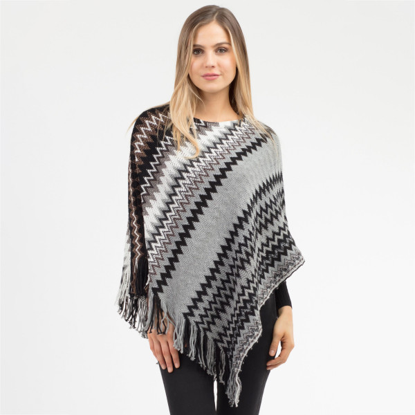 """Multicolor chevron print poncho with fringes.  - One size fits most 0-14 - Approximately 36"""" in length - 100% Acrylic"""