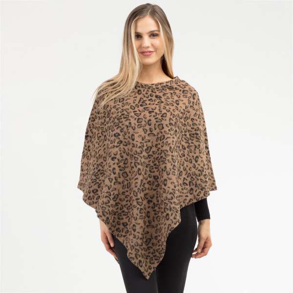 """Leopard print poncho.  - One size fits most 0-14 - Approximately 35"""" in length - 100% Polyester"""