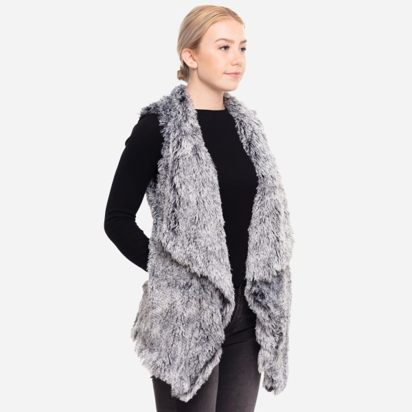 """Faux fur vest with pocket details.  - One size fits most 0-14 - Approximately 29"""" in length - 100% Polyester"""