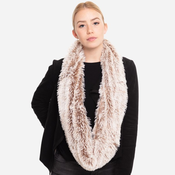 """Faux fur infinity scarf.   - Approximately 63"""" L x 7.5"""" W - 100% Polyester"""