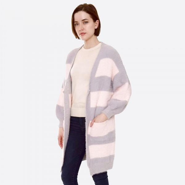 "Color-block cardigan with front pocket details.   - One size fits most 0-14 - Approximately 35"" in length - 80% Polyester, 20% Acrylic"