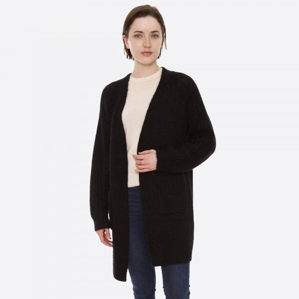 "Solid color fuzzy knit cardigan with front pocket details.  - One size fits most 0-14 - Approximately 30"" in length - 100% Acrylic"