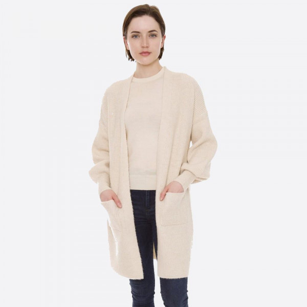"Solid color knit cardigan with ballon sleeves and front pocket details.  - One size fits most 0-14 - Approximately 32"" in length - 100% Acrylic"