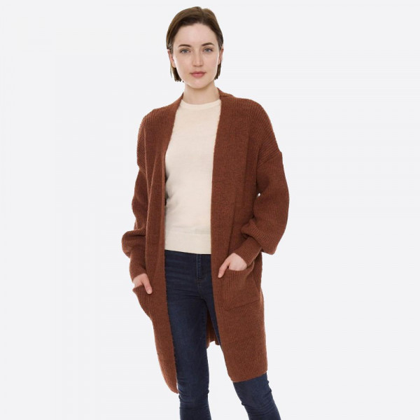 """Solid color knit cardigan with ballon sleeves and front pocket details.  - One size fits most 0-14 - Approximately 32"""" in length - 100% Acrylic"""