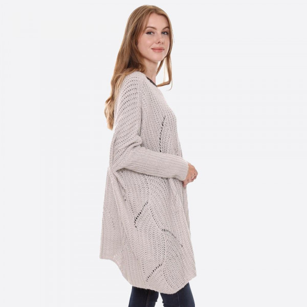 """Solid color oversized open knit sweater with scallop hem detail.  - One size fits most 4-22 - Approximately 29"""" in length - 100% Acrylic"""