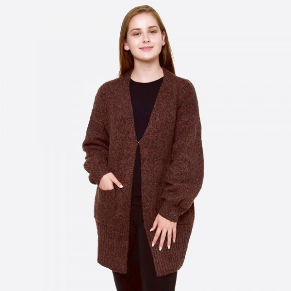 "Two tone knit cardigan with front pocket details.   - One size fits most 0-14 - Approximately 31"" in length - 100% Polyester"