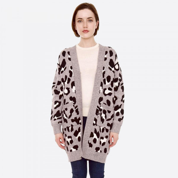 "Leopard print knit cardigan with front pocket details.  - One size fits most 0-14 - Approximately 32"" in length - 22% Polamide, 28% Polyester, 50% Viscose"