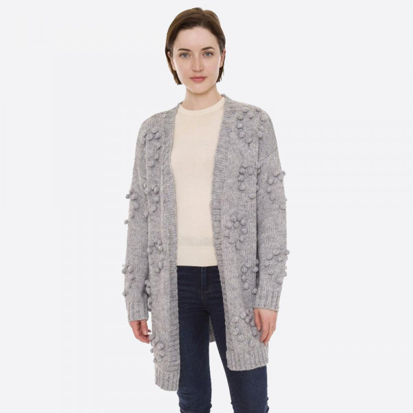 "Knit cardigan with pom pom details.   - One size fits most 0-14 - Approximately 30"" L - 50% Acrylic, 50% Polyester"