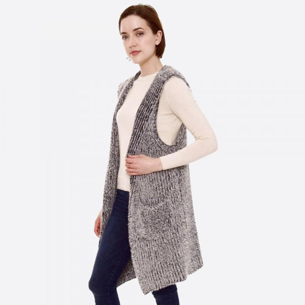 """Fuzzy brioche knit hooded vest with pocket details.  - One size fits most 0-14 - Approximately 40"""" in length - 100% Acrylic"""