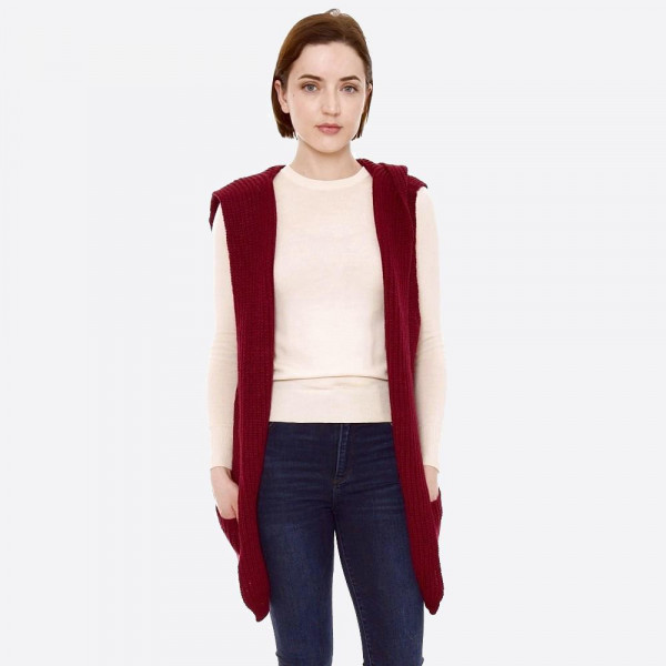 """Solid color marled knit hooded vest with front pockets.  - One size fits most 0-14 - Approximately 30"""" L  - 100% Acrylic"""