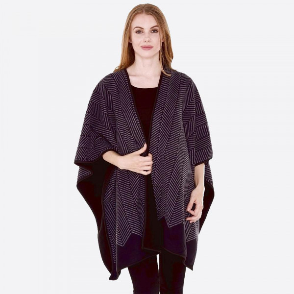 """Soft black geometric pattern reversible fleece ruana/wrap.  - One size fits most 0-14 - Approximately 32"""" in length. - 100% Polyester"""