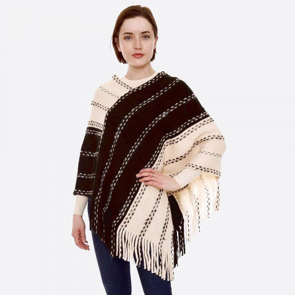 "Two tone whip stitch poncho with fringes.   - One size fits most 0-14 - Approximately 35"" in length  - 100% Acrylic"