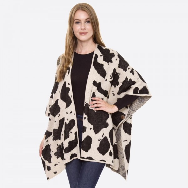 "Cow print winter kimono with coconut sleeve faux button details.  - One size fits most 0-14 - Approximately 26"" in length - 100% Acrylic"
