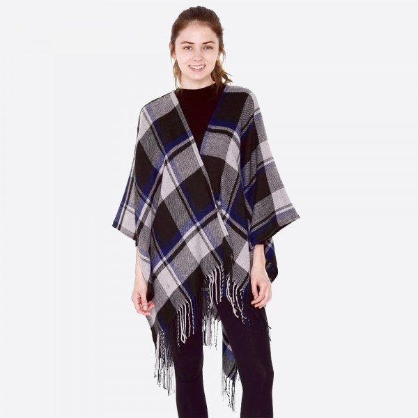 """Plaid pattern ruana/wrap with fringes.  - One size fits most 0-14 - Approximately 33"""" in length - 100% Acrylic"""