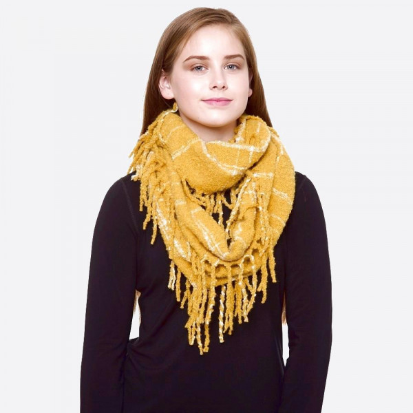 """Soft touch plaid print infinity scarf with fringes.  - Approximately 12"""" W x 64"""" L - 100% Acrylic"""