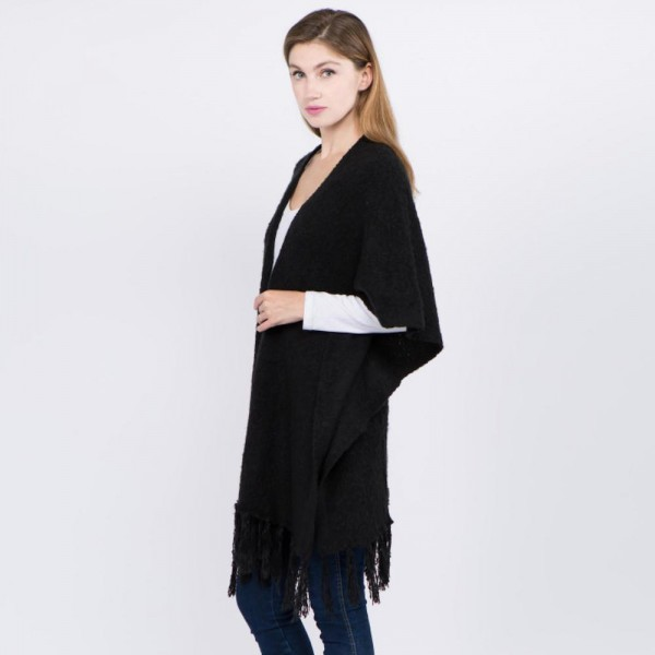 """Oversized soft knit ruana with fringes.  - One size fits most 0-14 - Approximately 35"""" in length - 100% Polyester"""