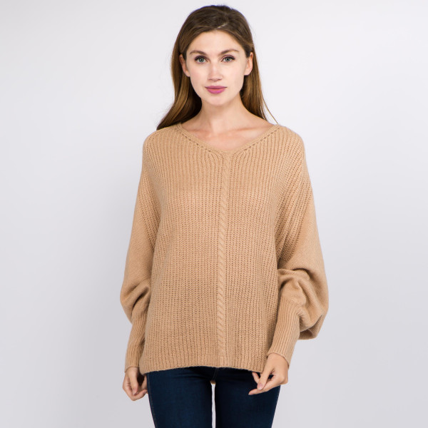 "Solid color knitted v-neck balloon sleeve sweater.  - One size fits most 0-14 - Approximately 22"" in length  - 100% Acrylic"