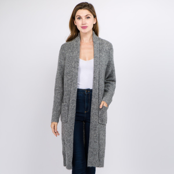 "Solid color soft touch knit long cardigan with front pocket details.  - One size fits most 0-14 - Approximately 36"" in length - 70% Acrylic, 27% Polyamide, 3% Spandex"
