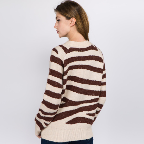 Soft touch fuzzy knit tiger stripe sweater.  - One size fits most 0-14 - Approximately  - 66% Acrylic, 30% Polyester, 4% Spandex