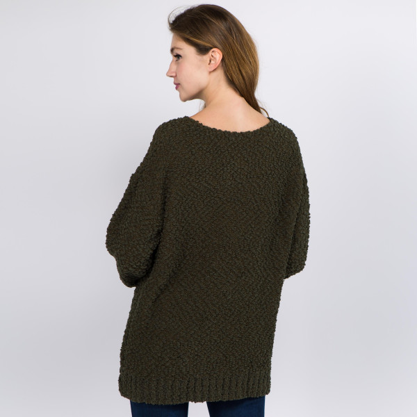 "Solid color popcorn knit sweater.  - One size fits most 0-14 - Approximately 24"" in length - 100% Polyester"